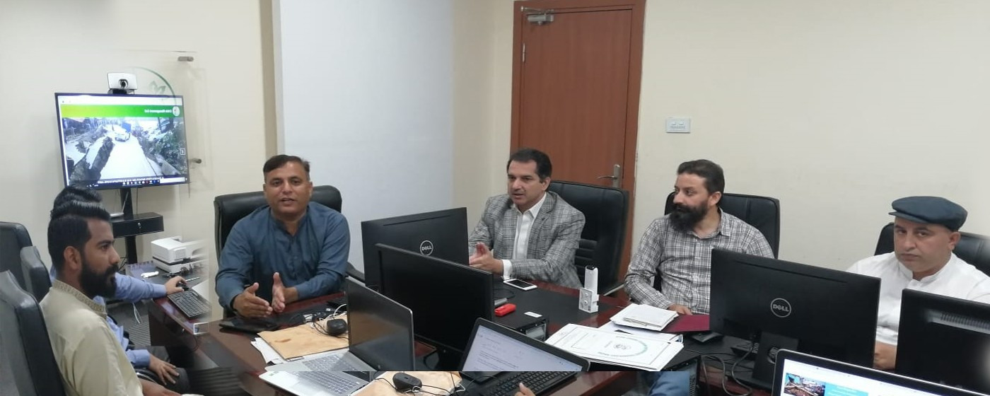 Minister ITB & TEVTA AJ&K Dr. Mustafa Bashir Abbasi is being briefed by DG IT Dr. Khalid Rafique regarding technical assistance and Software developed by IT Board for Crisis Management in Earthquake affected areas.